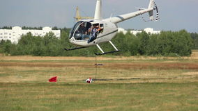 White helicopter takes off up, helicopter games. Helicopter takes off, goes down, extreme games in the helicopter near the forest, a helicopter airport, rescue stock footage