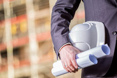 White helmet and blueprints on construction site Royalty Free Stock Photos