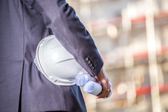 White helmet and blueprints on construction site Royalty Free Stock Images