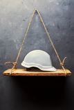 White helmet on the old wood shelf Stock Image