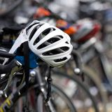 White helmet placed on the handlebars of a bike. In the transition zone royalty free stock photography