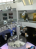 White helmets hanging in the air. White helmets hanging from ceiling in building Stock Image