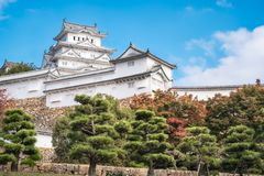 The White Heron Castle on the park grounds with pine trees on a beautiful autumn day. Himeji Castle is considered most beautiful castle in Japan and the stock images
