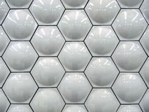White Hexagon Tiles. White hexagon bubble shaped ceramic wall tiles in background pattern royalty free stock photo