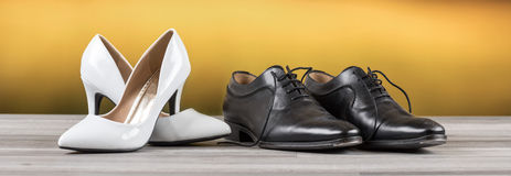 White high heel shoes and luxury black male shoes Stock Image