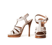 White high-heeled shoes. On a white background Stock Photos