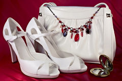 White high-heeled shoes and handbag with necklace. Of semiprecious gems Royalty Free Stock Images