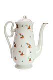 White high teapot with rose hips Royalty Free Stock Image