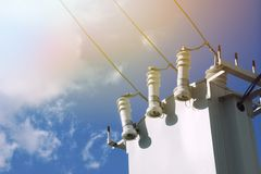 White high voltage transformer on blue sky background. Sunlight Royalty Free Stock Photography