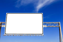 White highway sign. With blue sky in the background royalty free stock photo