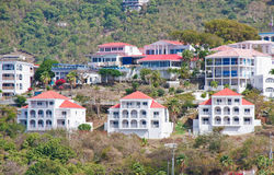 White Hillside Condos with Red Roofs in Tropics Stock Image
