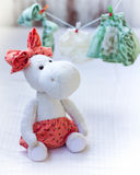 White hippo toy with textile and sewing accessory Stock Image