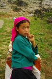 White Hmong ethnic girl. Only at the roadside this Hmong girl waits her white mother who goes up the trail from the bottom of the valley Royalty Free Stock Photos