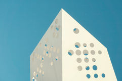White Hole Punch Architecture Under a Blue Sky Royalty Free Stock Photography