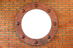 White hole in red brick wall Royalty Free Stock Images