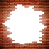 White hole in red brick wall Stock Photo