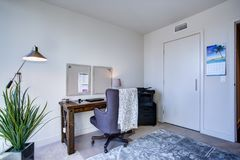White home office interior in luxurious apartment royalty free stock photography