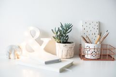 White home office table, cozy and nice workplace with notepads a Royalty Free Stock Photography