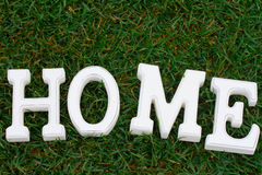White Home sign on grass Stock Images