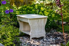 White homemade stool on the background of nature stock photo