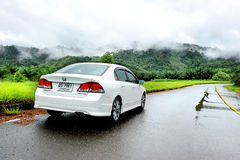 White Honda Civic car in the wet road Stock Image