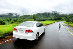 White Honda Civic car in the wet road Stock Photos