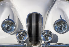 White Hood and grill with Chrome Headlamps Spot Lamps Stock Images
