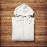 White hoodie on wood background Stock Photo