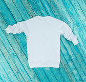 White hoody on blue background. Royalty Free Stock Image