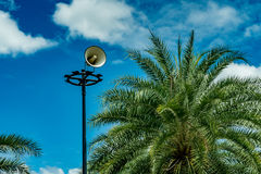 White horn speaker. On white cloud background in the park Royalty Free Stock Photo