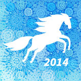 White horse on blue snowflakes background. Royalty Free Stock Photography