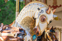 White Horse. A white horse of a carousel in a park Stock Images
