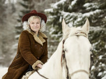 White horse and riding woman Stock Photography