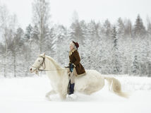 White horse and riding woman Royalty Free Stock Photos