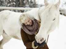 White horse and woman Royalty Free Stock Photo