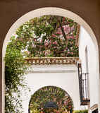 White Horseshoe Arches Pink Flowers Alcazar Royal Palace Seville Royalty Free Stock Image