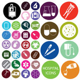 White hospital icons and colorful circle Stock Images