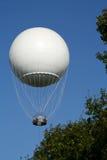 White hot air ballon in the air. Above the trees Stock Photos