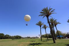 White hot air balloon in the blue sky Royalty Free Stock Photo