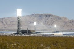 White Hot Mojave Desert Solar Power Towers. Ivanpah, California, USA - May 14, 2014:  Three glowing white hot towers at the newly operational 392 megawatt Royalty Free Stock Image