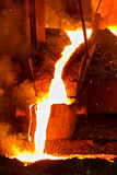 White hot molten metal. In a foundry crucible Stock Photography