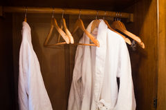 White Hotel gown on a hanger in the wardrobe Stock Images