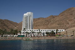 White hotel on the shore Stock Photos