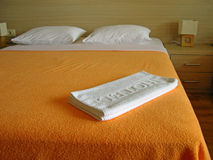 White hotel towels on the bed Stock Photo