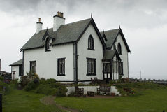 White house in St Abbs. A white house in St Abbs in Scotland on a rainy day Royalty Free Stock Photography