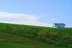White House. A house on the horizon invokes the feel of an Edward Hopper painting Royalty Free Stock Photo