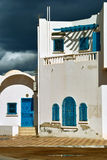 White house in arabic style on Djerba. White house in arabic style with painted windows and doors in traditional turquoise blue on Djerba, Tunisia Royalty Free Stock Photo