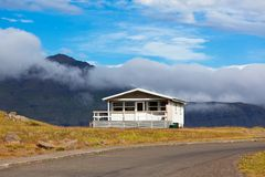 White House and Asphalt Road in East Iceland Royalty Free Stock Photo