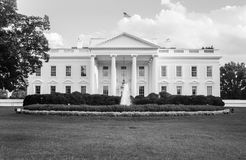 The White House in black and white. The official residence of the President of the United States in Washington, D.C. lit by the setting sun in the evening. Black Stock Images