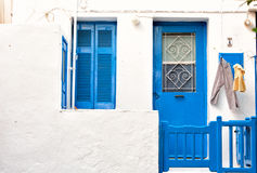 White house with blue door and window  Mykonos  Greece Royalty Free Stock Photo